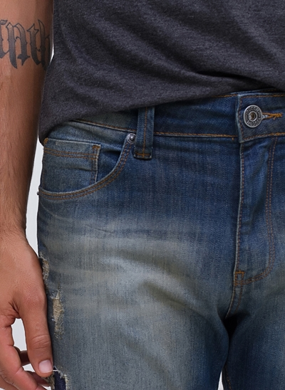 Calça Skinny Destroyed em Jeans Used
