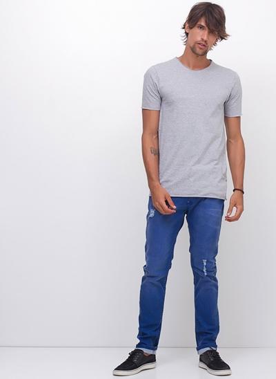 Calça Skinny em Jeans Resinado